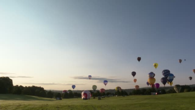 bristol international balloon fiesta begins secretly to avoid crowds england bristol various shots of hot air balloons taking off and in flight at... - traditional festival stock videos & royalty-free footage