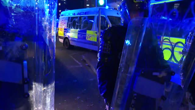 bristol 'kill the bill' protest; england: bristol: ext / night **warning bad language, flashing lights** riot police with shields and helmets by... - smoke physical structure stock videos & royalty-free footage