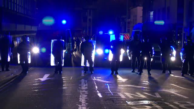 bristol 'kill the bill' protest; england: bristol: ext / night **warning bad language, flashing lights** helicopter overhead riot police with shields... - dog stock videos & royalty-free footage