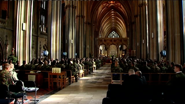 bristol memorial service for soldiers killed in afghanistan england avon bristol int back views of soldiers and general congregation members taking... - votive candle stock videos and b-roll footage