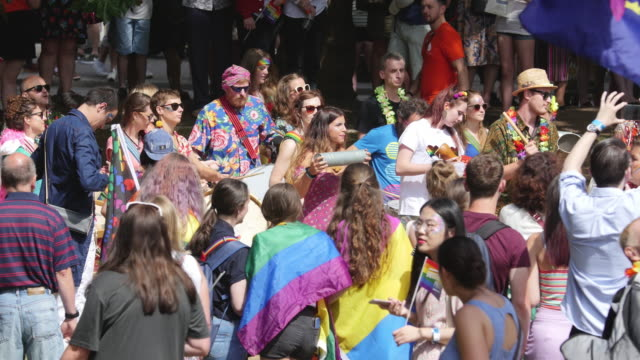 crowd of people gathered for parade in city park - bisexuality stock videos and b-roll footage