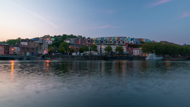 bristol skyline and bristol marina during sunset in south west england, day to night, 4k time-lapse - bristol england stock videos & royalty-free footage