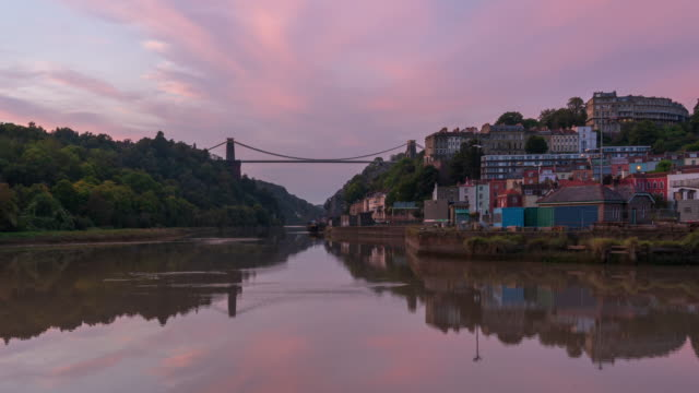 bristol skyline, river avon, and clifton suspension bridge in south west england, day to night, 4k time-lapse - bristol england stock videos & royalty-free footage