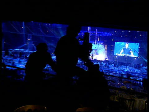 brit awards 1997; england: london: earls court: int bv silhouette of camera crew filming on balcony as along on camera dolly l-r - earls court stock videos & royalty-free footage