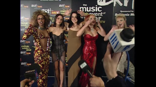 vídeos de stock e filmes b-roll de red carpet interviews part two england london earl's court gvs the spice girls posing for photocall mel b victoria adams mel c geri halliwell emma... - spice girls