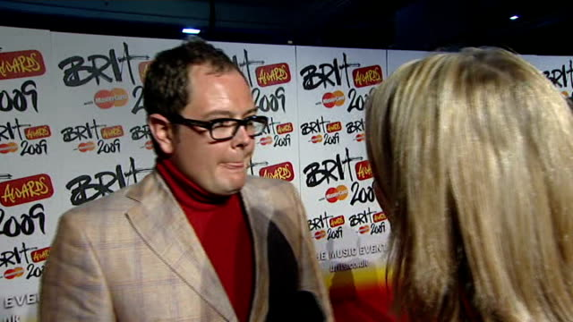 backstage intvws ITN ITV Alan Carr interview SOT on giving award for best single on Robbie possibly being there