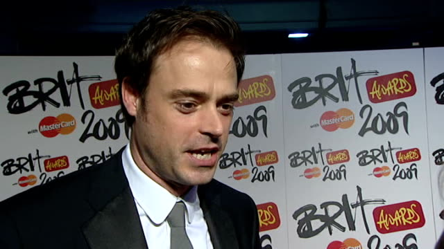 brit awards: backstage intvws itn itv; jamie theakston interview sot - hope its big year for heavy metal, they get overlooked - think coldplay, duffy... - jamie theakston stock videos & royalty-free footage