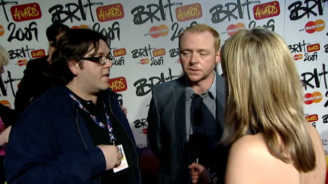 backstage intvws ITN ITV Nick Frost and Simon Pegg interview SOT on presenting awards on who they want to win Estelle or Duffy Coldplay