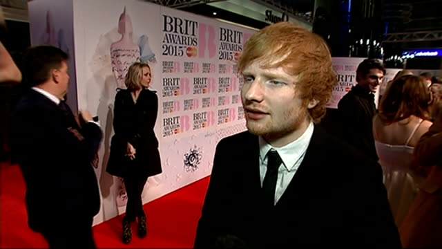 madonna falls off stage england london o2 arena ext ed sheeran interview sot don't really think its a battle of the boys though we'll see these award... - ブリット・アワード点の映像素材/bロール