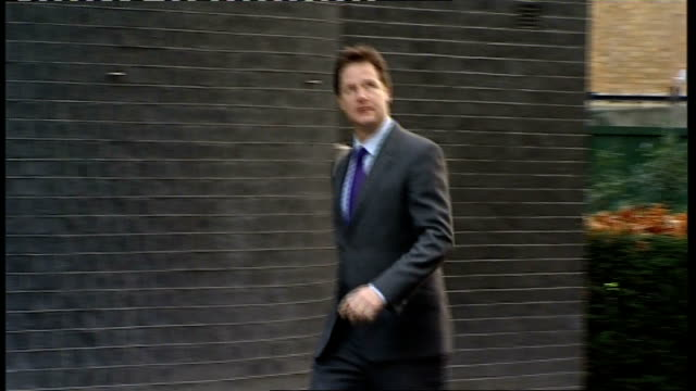 britain and france clash over economic statements downing street ext deputy prime minister nick clegg mp along and into number 10 which has large... - politician stock videos & royalty-free footage