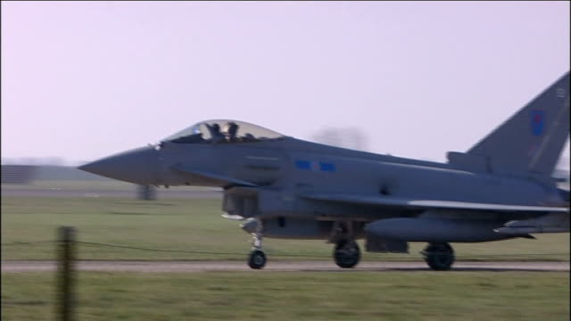 britain and france join forces to develop unmanned fighter jet 2232011 raf coningsby raf eurofighter typhoon jets flying overhead and taxiing on... - リンカンシャー点の映像素材/bロール