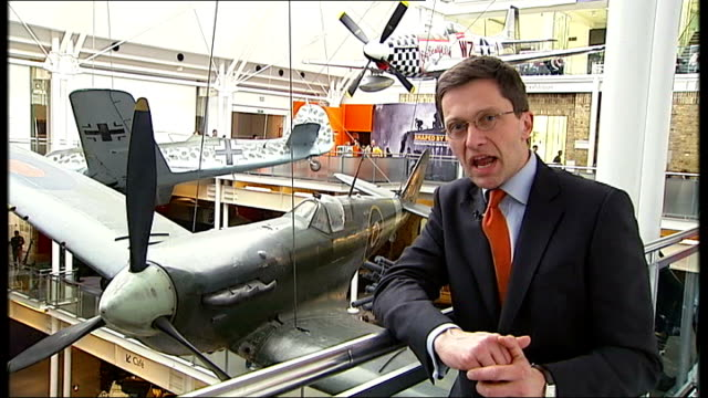 stockvideo's en b-roll-footage met britain and france join forces to develop unmanned fighter jet england london imperial war museum int reporter to camera spitfire plane on display in... - imperial war museum museum