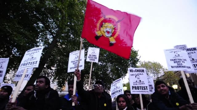 britain based tamils demonstrated opposite downing street in central london friday against british prime minister david camerons visit to sri lanka... - pms stock videos and b-roll footage