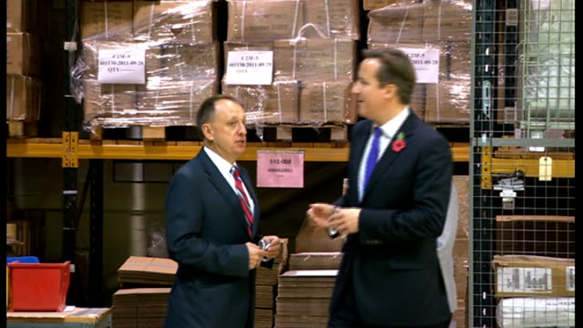 stockvideo's en b-roll-footage met britain out of recession as gdp grows england london wandsworth panorama antennas factory int david cameron mp meeting staff on factory floor of... - wandsworth