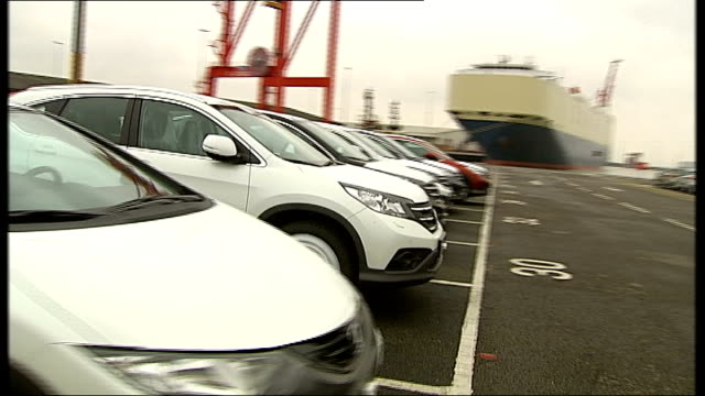 Britain out of recession as GDP grows ENGLAND Somerset Bristol EXT Lexus hybrid 4x4 cars driven towards off ship at port 'KOBE' Japanese sign on side...