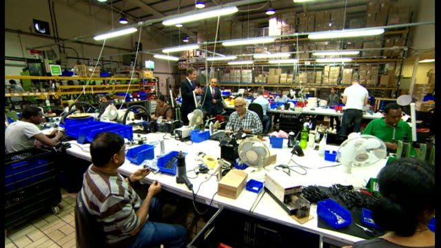 britain out of recession as gdp grows london int gvs david cameron mp meeting workers on tour of antenna manufacturers david cameron mp interview sot... - ファイサル・イスラム点の映像素材/bロール