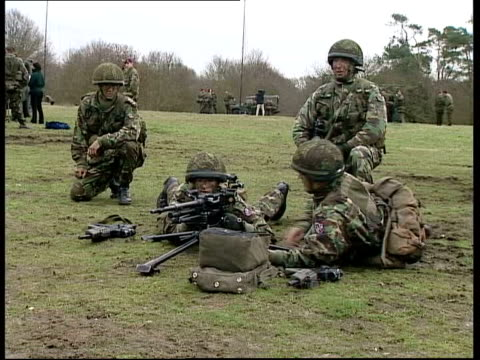 usa britain reject international concerns itn england essex near colchester cms soldier of the 16th air assault brigade crouched next to a field gun... - reuters stock videos & royalty-free footage