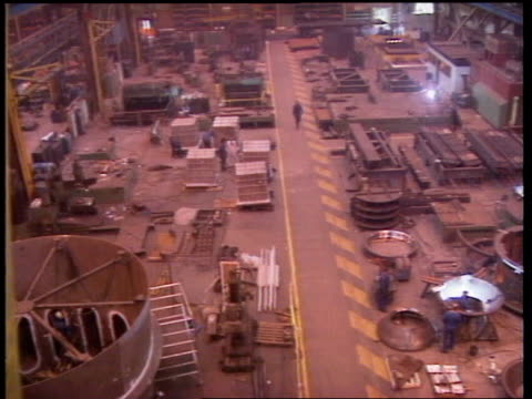 britain still in recession; itn lib england: sheffield tgv track forward over engineering shop floor - recession stock videos & royalty-free footage