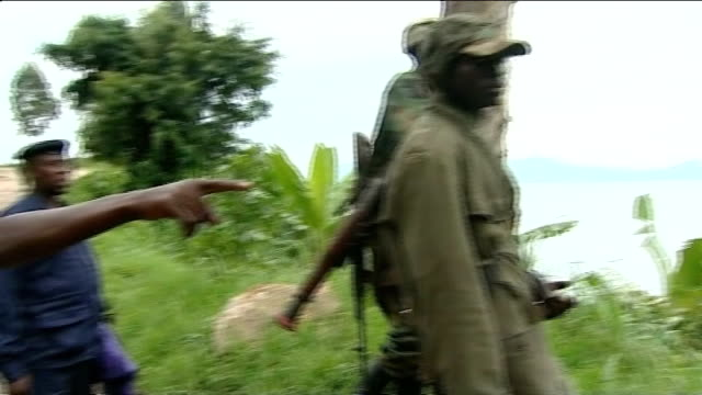 britain stops aid donation over support for drc rebels ext rebel m23 soldiers stand on hillside looking out over landscape - コンゴ民主共和国点の映像素材/bロール