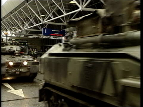 terrorist threat security precautions heathrow airport soldiers patrolling in apcs outside airport building bv convoy of apcs ms soldiers jumping... - terrorism stock videos & royalty-free footage