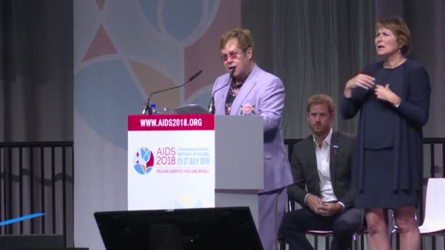 vídeos de stock, filmes e b-roll de britain's elton john and prince harry launch a $12 billion initiative to fight aids transmission by targeting young men during a major international... - realeza britânica
