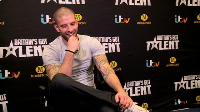 'britain's got talent': darcy oake interview; oake chatting with reporter sot - britain's got talent stock-videos und b-roll-filmmaterial