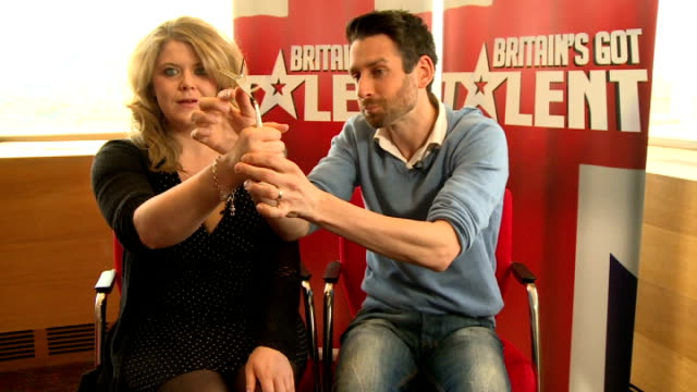 britain's got talent interview finalist jamie raven raven and reporter doing magic trick / jamie raven interview continued sot / gvs raven - finalist stock videos and b-roll footage