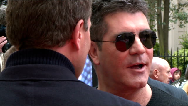 britain's got talent launch interviews car / mezghan hussainy along / simon cowell out of car with sinitta / cowell posing for photographs / cowell... - britain's got talent stock-videos und b-roll-filmmaterial
