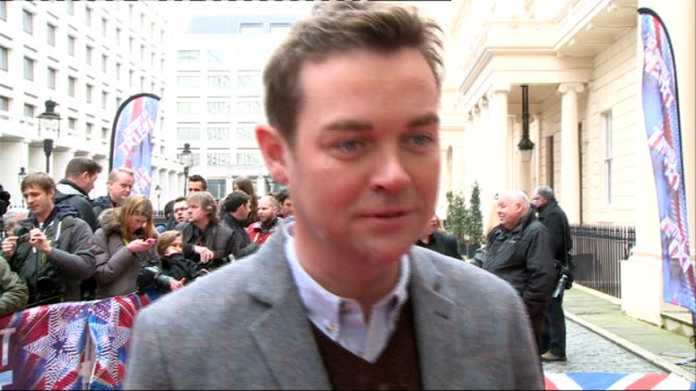 britain's got talent launch interviews; england: london: ext **beware flash photography** stephen mulhern chatting with others / union jack carpet on... - britain's got talent stock-videos und b-roll-filmmaterial