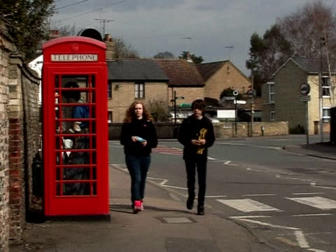 britain's iconic red phone booths have become obsolete in the age of the mobile phone, but villages across the country are hoping to give them a new... - new age stock-videos und b-roll-filmmaterial