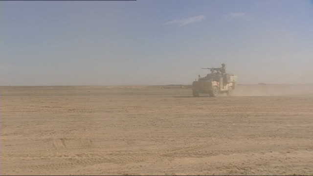 britain's lost war families claim poorly protected vehicles led to soldier deaths lib / helmand province land rover along in desert region - 2001年~ アフガニスタン紛争点の映像素材/bロール