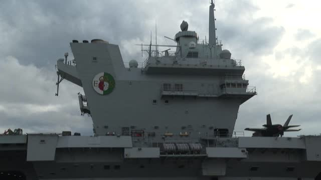 britain's new hms queen elizabeth aircraft carrier pays a port call to japan, in a mission that adds to pressure from tokyo, the us and allies on... - report produced segment stock videos & royalty-free footage
