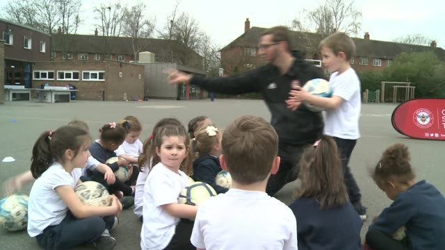 britain's only deaf fulltime football coach brentford ext lampert signing with group of children during coaching session ben lampert interview via... - sign language stock videos & royalty-free footage