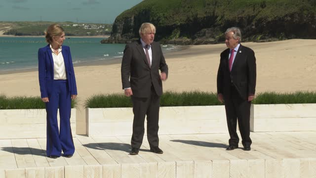 britain's prime minister boris johnson and his wife carrie johnson greet united nations secretary general antonio guterres at an official welcome at... - image stock videos & royalty-free footage