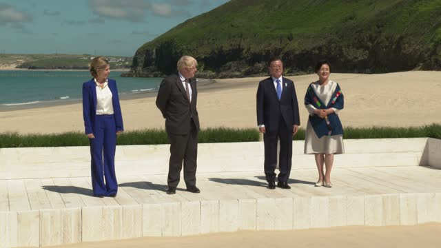 britain's prime minister boris johnson and his wife carrie johnson pose with south korea's president moon jae-in and wife kim jung-sook at the g7... - business finance and industry stock videos & royalty-free footage