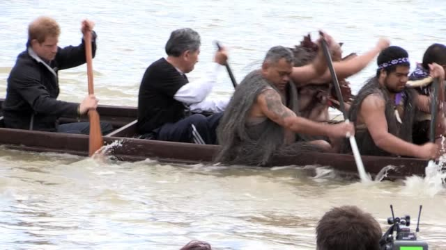 britain's prince harry experiences maori culture in new zealand, joining a group of grass skirted warriors for a canoe ride which leaves him knackered - new zealand culture stock videos & royalty-free footage