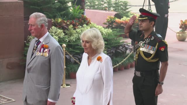 Britain's Prince of Wales Charles and wife Camilla Duchess of Cornwall brave heavy smog to visit a war memorial at India Gate in New Delhi on the...