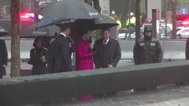 Britains Prince William and his wife Kate visited the 9/11 memorial in the pouring rain on Tuesday placing a bouquet at one of the reflection pools...