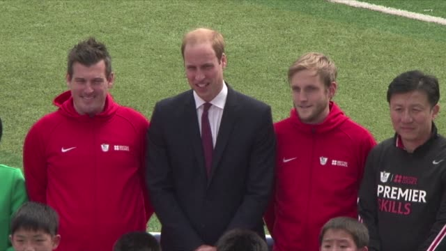 britain's prince william practises sports diplomacy in china striding onto the football pitch at a shanghai school - diplomacy stock videos and b-roll footage