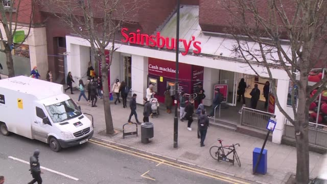 britain's second and third biggest supermarket chains sainsbury's and walmart owned asda are to merge creating a £13billion retail king that would... - leapfrog stock videos and b-roll footage