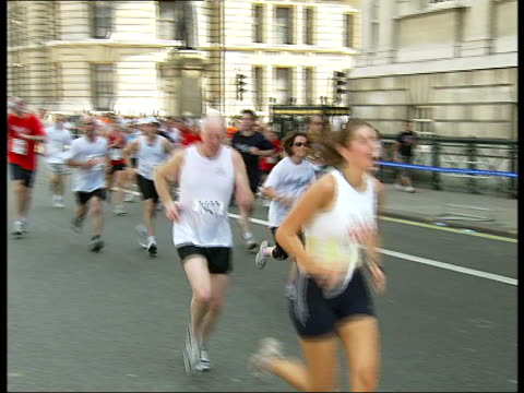 charity runners on westminster bridge / leisure seekers enjoying sunshine in park paramedics attending to runners who are suffering discomfort / male... - lying on side stock videos & royalty-free footage