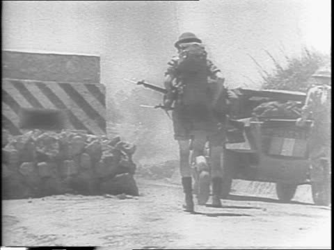 british 8th army sweeps forward in northeastern sicily / tanks are firing at the enemy on a battle field / montage of soldiers firing mortar guns /... - 1943 stock-videos und b-roll-filmmaterial