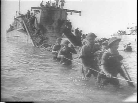 british 8th army troops unloading from transport boats at a sicily beachhead, follow ropes to shore / tanks and jeeps onto shore / italians help... - sicily stock videos & royalty-free footage