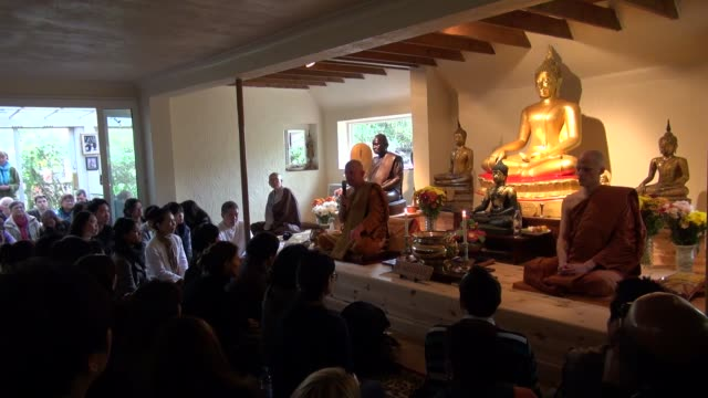 british abbot ajahn khemadhammo chatting at a buddhist ceremony to mark the last day of vassa at the forest hermitage in warwickshire, england, uk.... - theravada stock videos & royalty-free footage