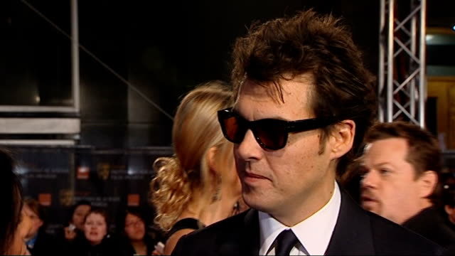 british academy film and television awards: red carpet arrivals; joe wright interview sot - ジョーライト点の映像素材/bロール