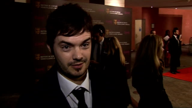 arrivals and interviews barney harwood interview sot on reason for being there / on nominees / on gaming habits / on whether it's ok to be a blue... - blue peter stock videos and b-roll footage