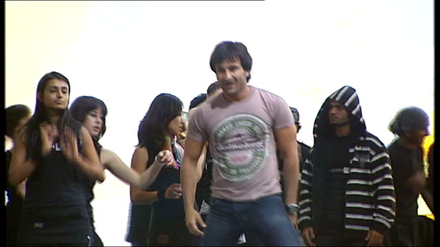 british actors starring in bollywood films england int **music heard sot** saif ali khan dancing on stage with others katrina kaif watching saif ali... - bollywood stock videos and b-roll footage