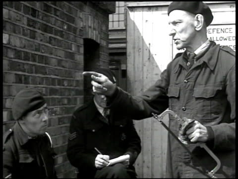 british air wardens sitting talking against brick wall ' if we get all the things the government's promised i think we'd be okay don't you' 'if we... - postwar stock videos and b-roll footage