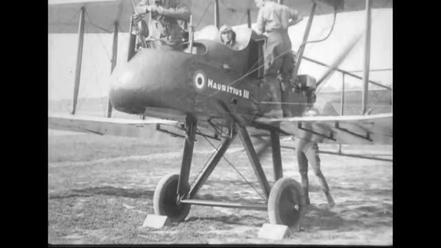 british airplanes reconnoiter / soldier checking machine gun / airplanes taking off / aerial of battlegrounds - world war one stock videos & royalty-free footage