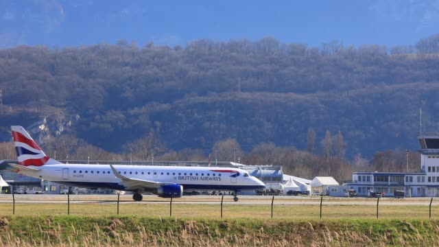 british airways aeroplane taxi at the chambery savoie mont blanc airport as british tourists arrive for ski holidays in the french alps - european alps stock videos & royalty-free footage